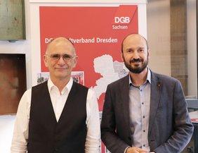 Pfarrer Behr und Geschäftsführer Schnabel vom DGB